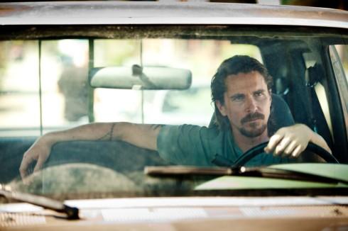 "Christian Bale sporting his ""American man"" look."